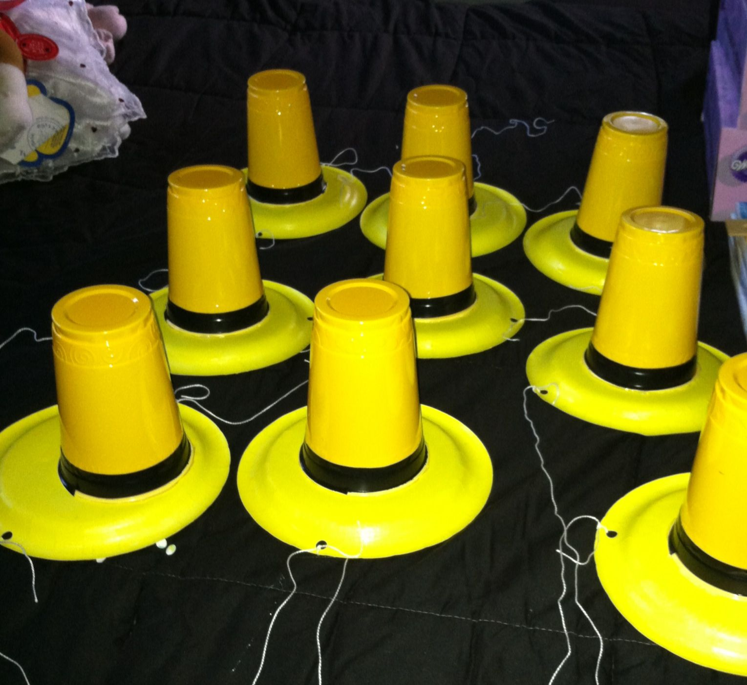 453d8c8791a Curious George man in the yellow hat party hats. Yellow plates yellow cup  and some electrical tape.