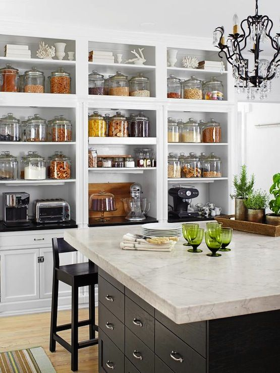 d45f84868882 Fantastic wall of built-in open shelving for pantry staples and small  kitchen appliances. White Shaker fronted cabinets pair with a black granite  top.