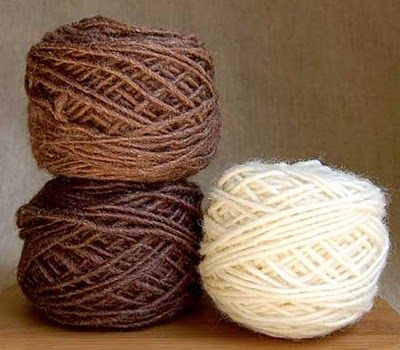 I like the two brown yarn balls. These two shades would used for George's suit.
