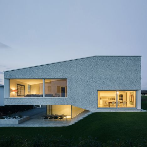 Split level house by kit works with the slope of the for Split level kit homes