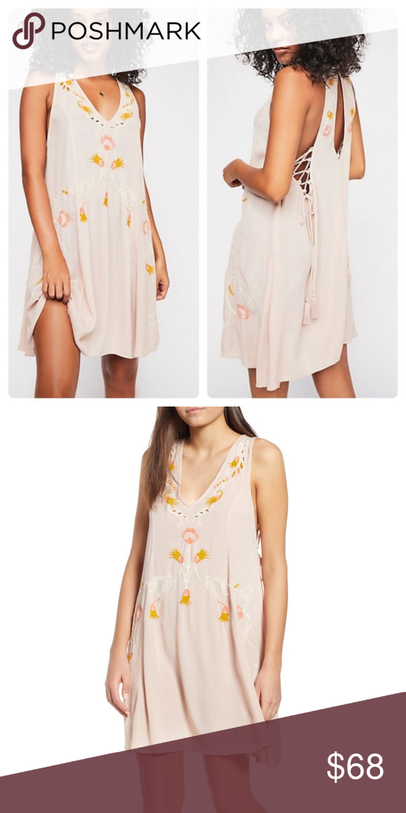 423729dd4197 NWT Free People Adelaide Festival Slip dress Get into the swing of festival  season with this flowy embroidered shift dress. V-neck - Sleeveless - Back  ...