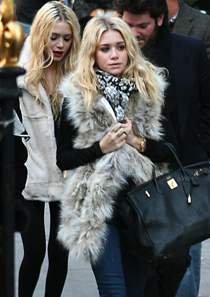 I'm kind of in love with Ashley Olsen's fur vest (faux for me!) with a pure back long sleeve shirt, skinny jeans, print scarf, and oversized bag.
