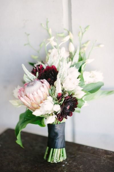 A fall themed bouquet with a pretty protea: http://www.stylemepretty.com/2014/10/08/modern-and-romantic-vineyard-wedding-inspiration-in-portland-oregon/ | Photography: Christa-Taylor - http://christataylorphotography.com/
