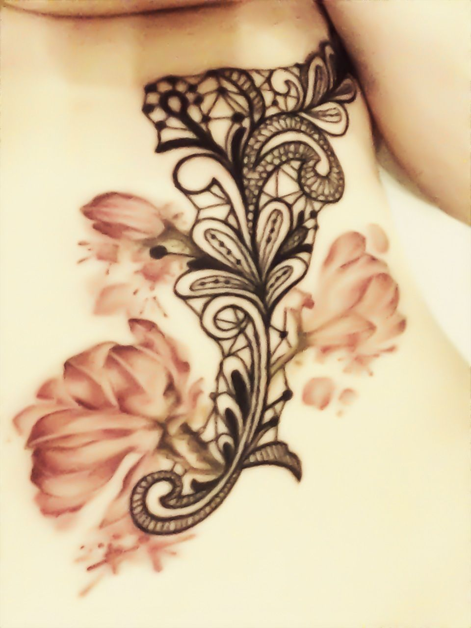 70621fbbb Tattoo over ribs, lace with flower work done by Aimee at Skinks in  Hamilton! Love the soft color of the flowers!