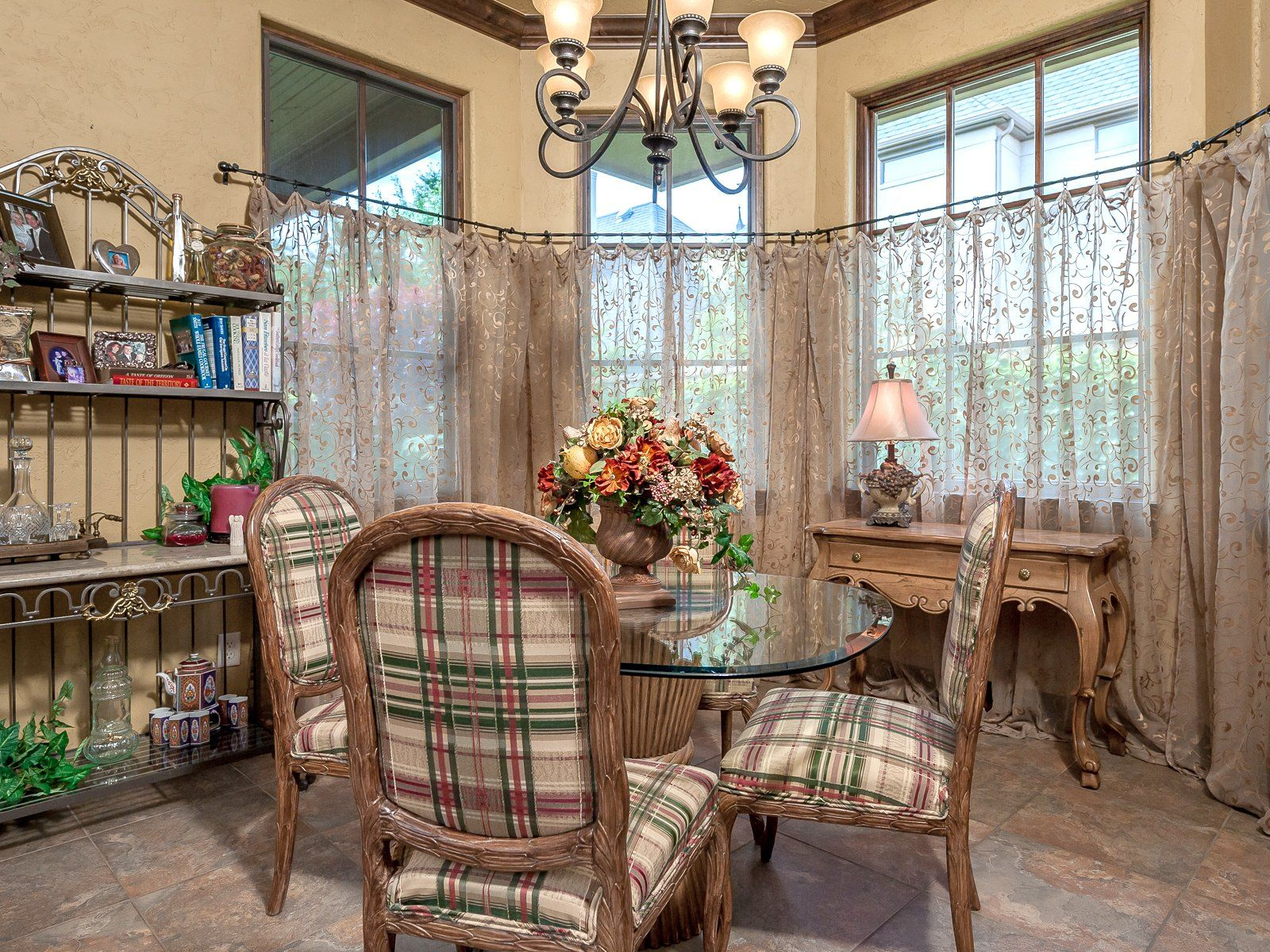 Small Country Dining Room With Sheer Floral Curtains