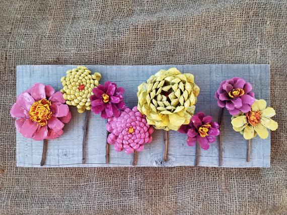Beautiful Hand Made And Painted Pincone Flowers On Repurposed Barn Wood This Piece Features 8 Pinecone Hanging Flower Wall Pine Cone Flower Wreath Pine Cones