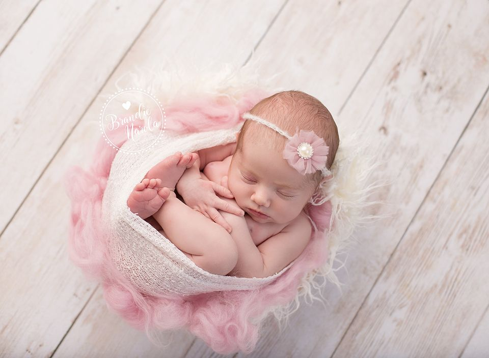 Baby girl newborn photography by brandie narola photography