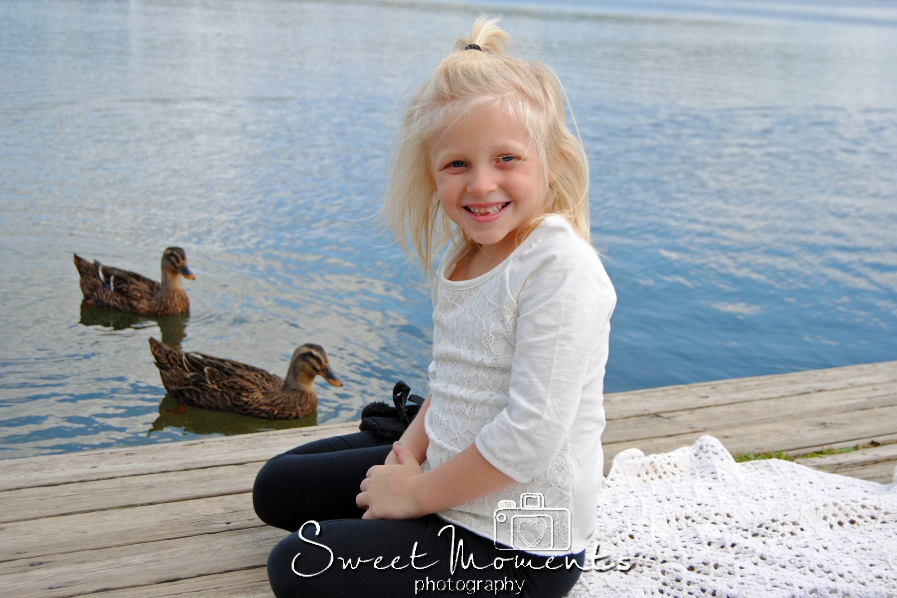 This is a little girl who got her 5 year pictures done at the lake!