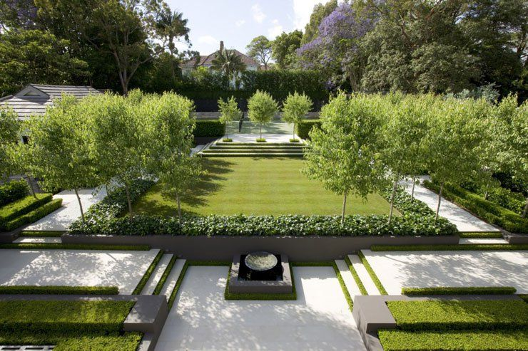 Well landscaped formal french garden with a modern feel for Modern landscape design