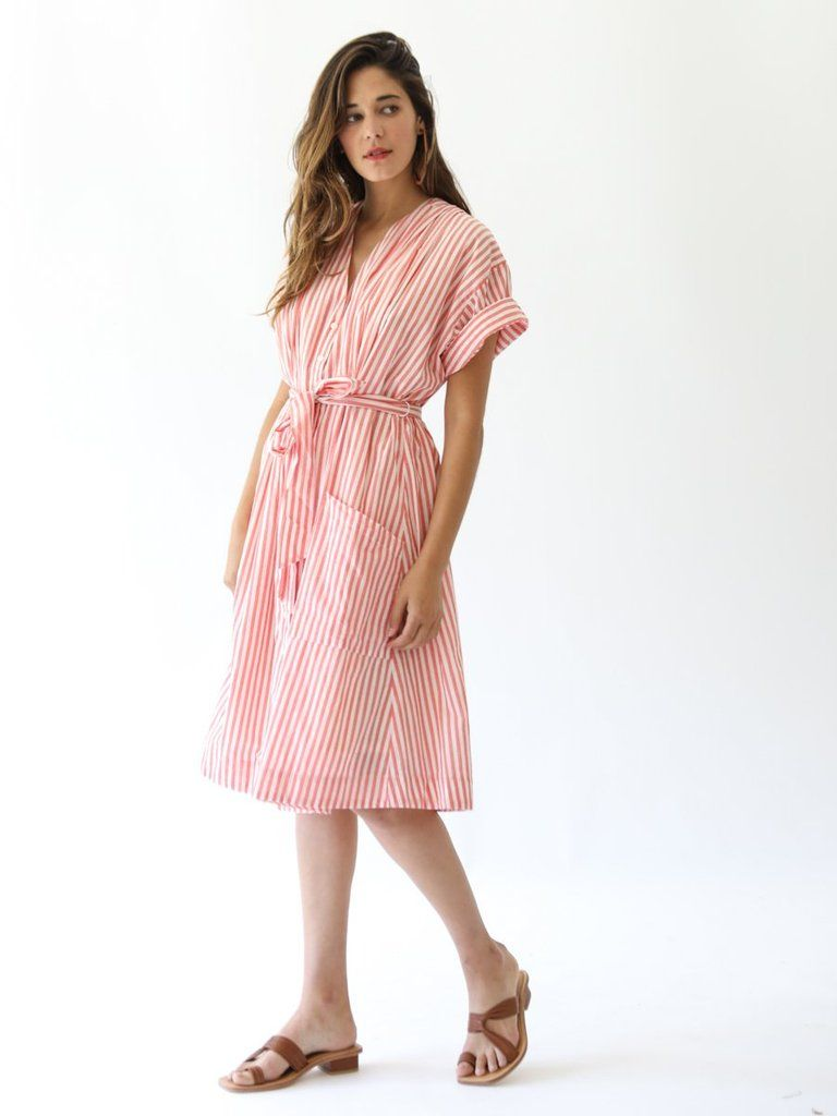 63681d0ec6c A new twist on a classic shirt dress. This mid-length dress has a  V-neckline and buttons down the front. The Sophie also has pleat details to  create a ...