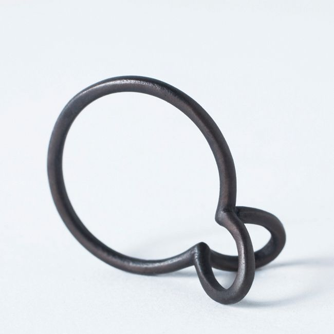 ring.  two symmetrical arches are defined at the intersection of three independent circles. by silva/bradshaw