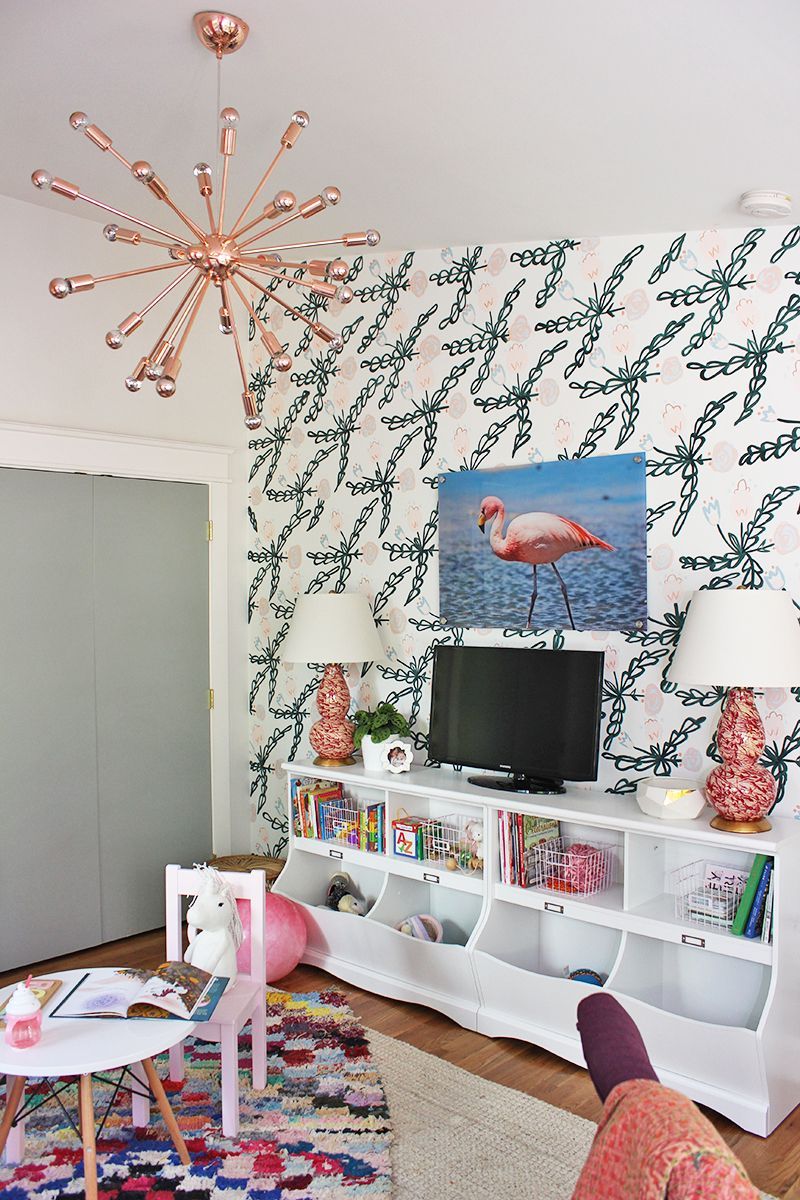 Interesting Playroom Office Ideas safari themed boys playroom features a charcoal gray ceiling over walls clad in orange safari themed wallpaper lined with a wood daybed adorned with Moroccan Inspired Playroom And Office
