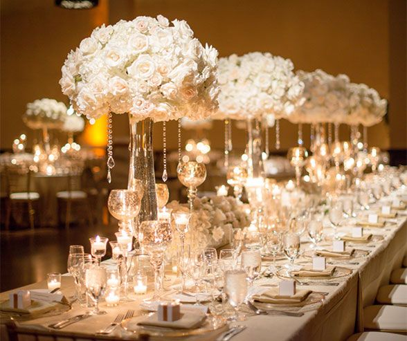 These white rose and peony arrangements are simply breathtaking with tear drop crystals dripping down the sides.