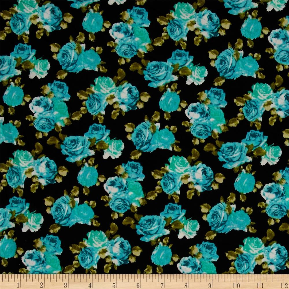 Crepe Floral Black/Aqua from @fabricdotcom  This trendy fabric features a matte crepe texture and mechanical 5% stretch across the grain. With such a fabulous fluid drape, this crepe is perfect for creating blouses, special occasion apparel, fuller skirts and dresses with a lining.