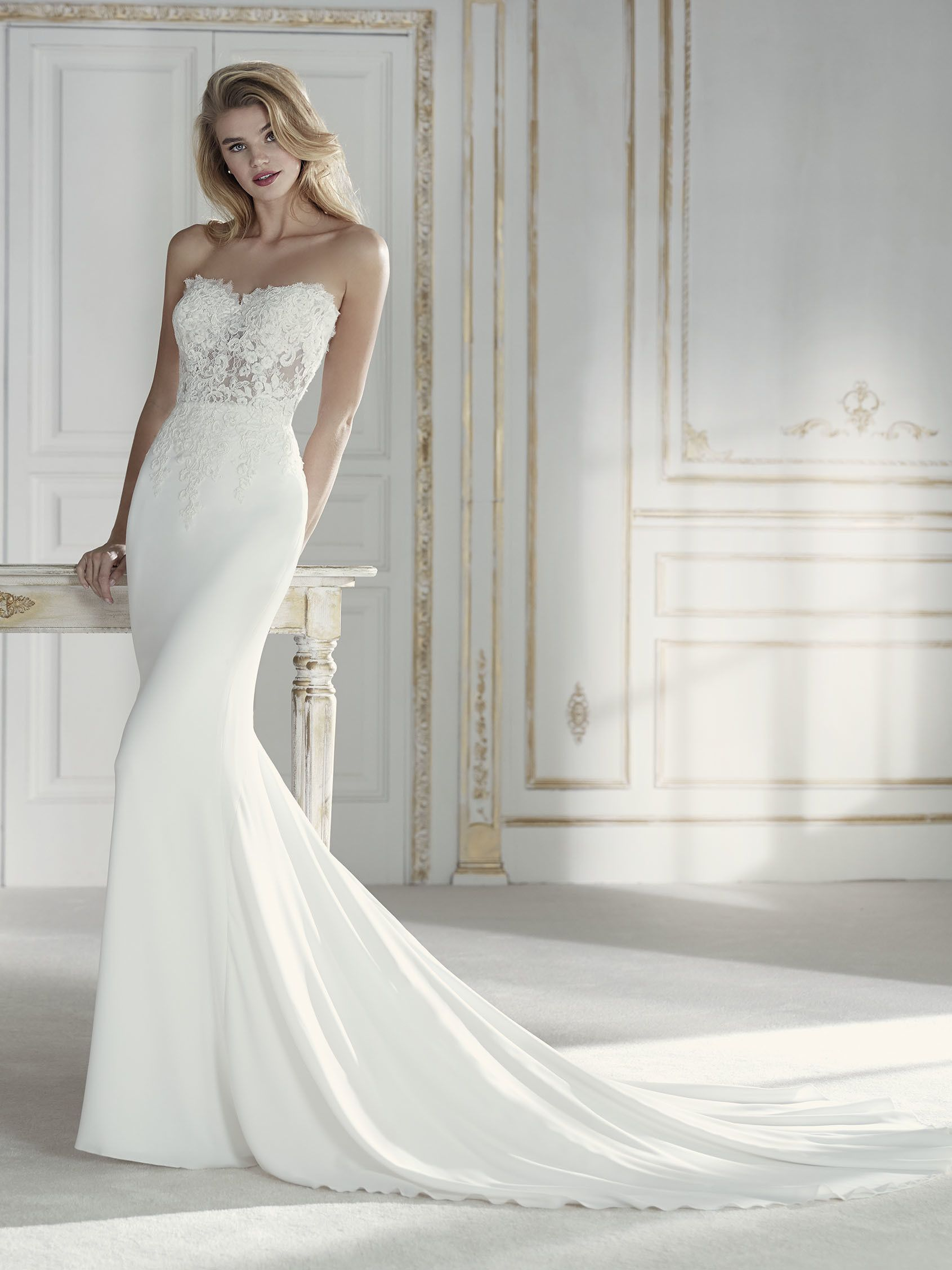 Low back lace mermaid wedding dress  Femininity takes the form of a wedding dress with this amazing