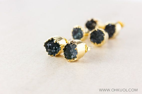 Encased in a glimmering and unique gold plated setting, these endlessly sparkling druzy studs will be the talk of the town wherever you go. Unique with a