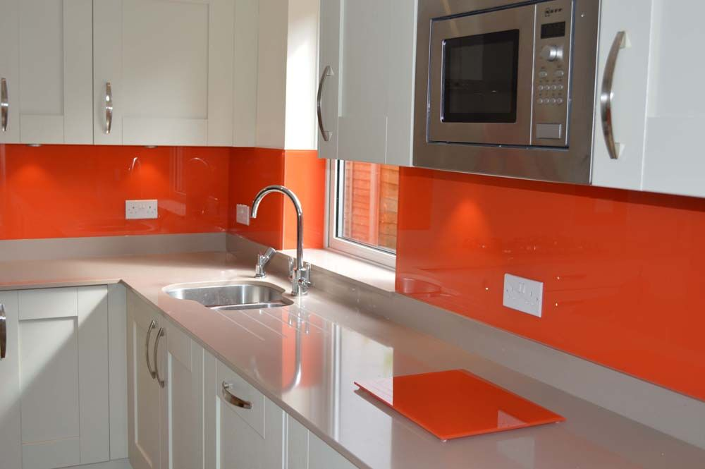 Pure Orange  Glass Colour Kitchen Splashback By CreoGlass Design (London,UK ).