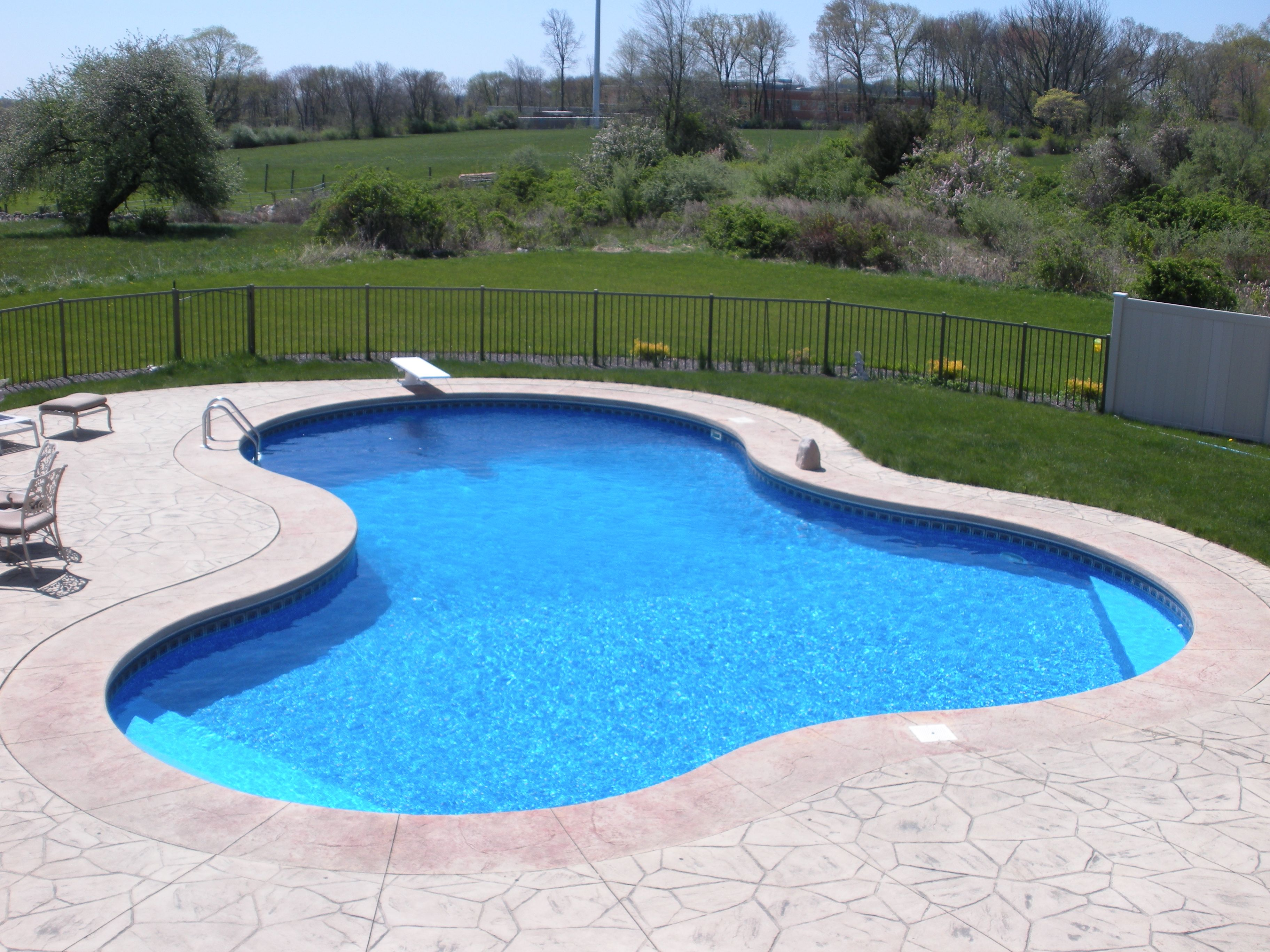 Lagoon Shaped In Ground Pool Legacyedition A1pools A1poolsct A1poolsandspas Affordable Swimming Pools Pool Designs Backyard Pool Landscaping