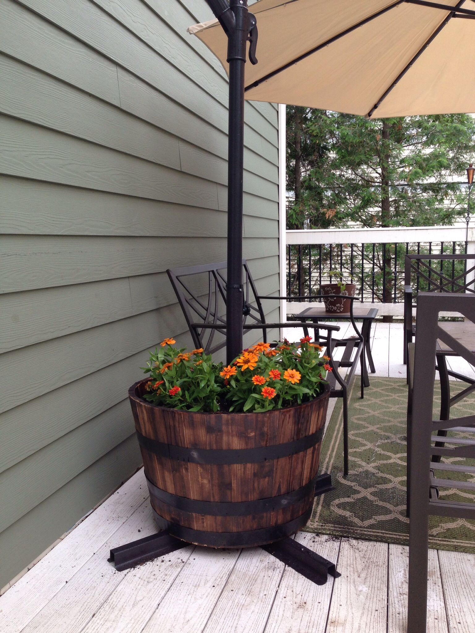 creative way to hold down a patio umbrella! | our 1st home