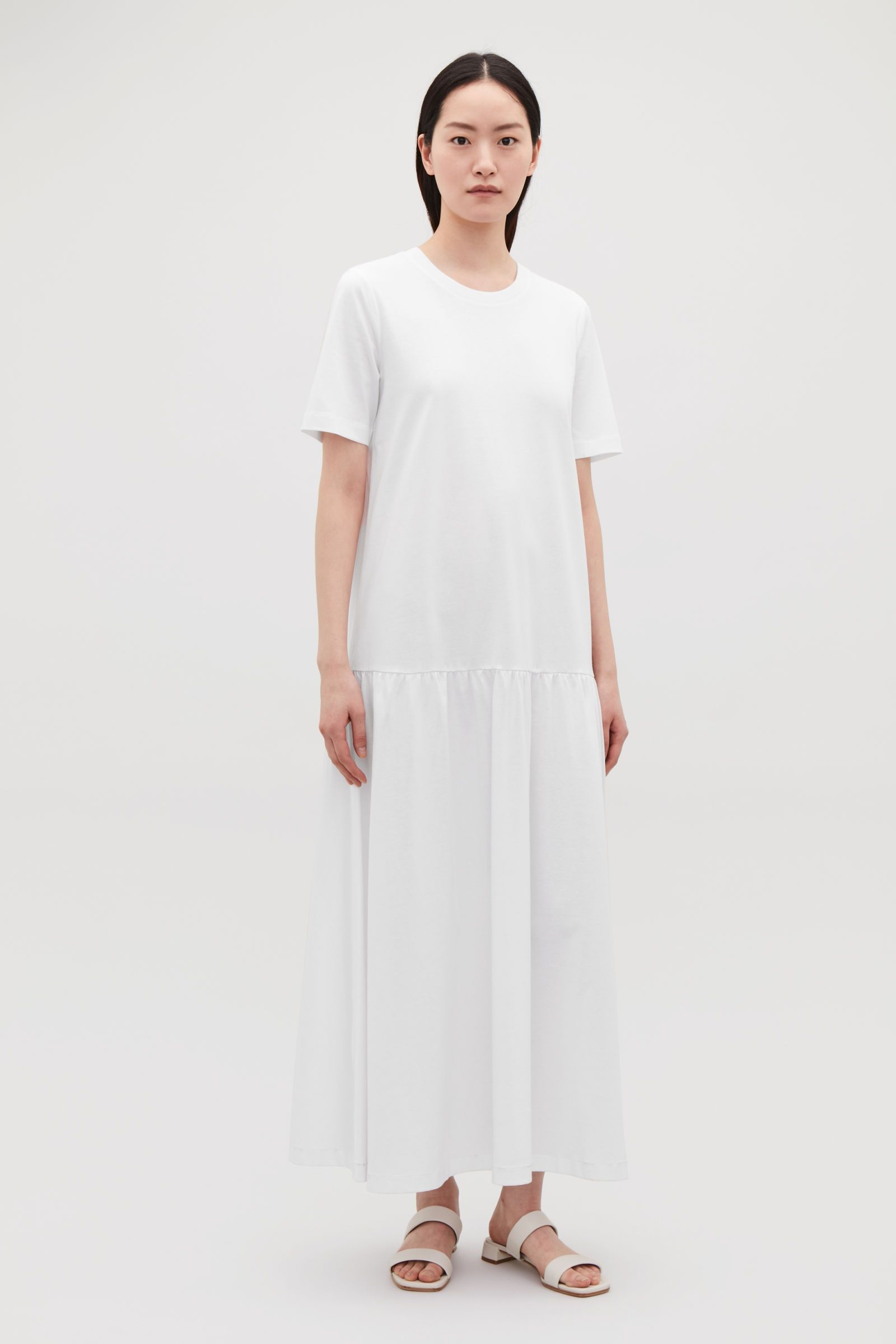 c0aa7ac41b3 Model front image of Cos long cotton dress with frilled hem in white ...