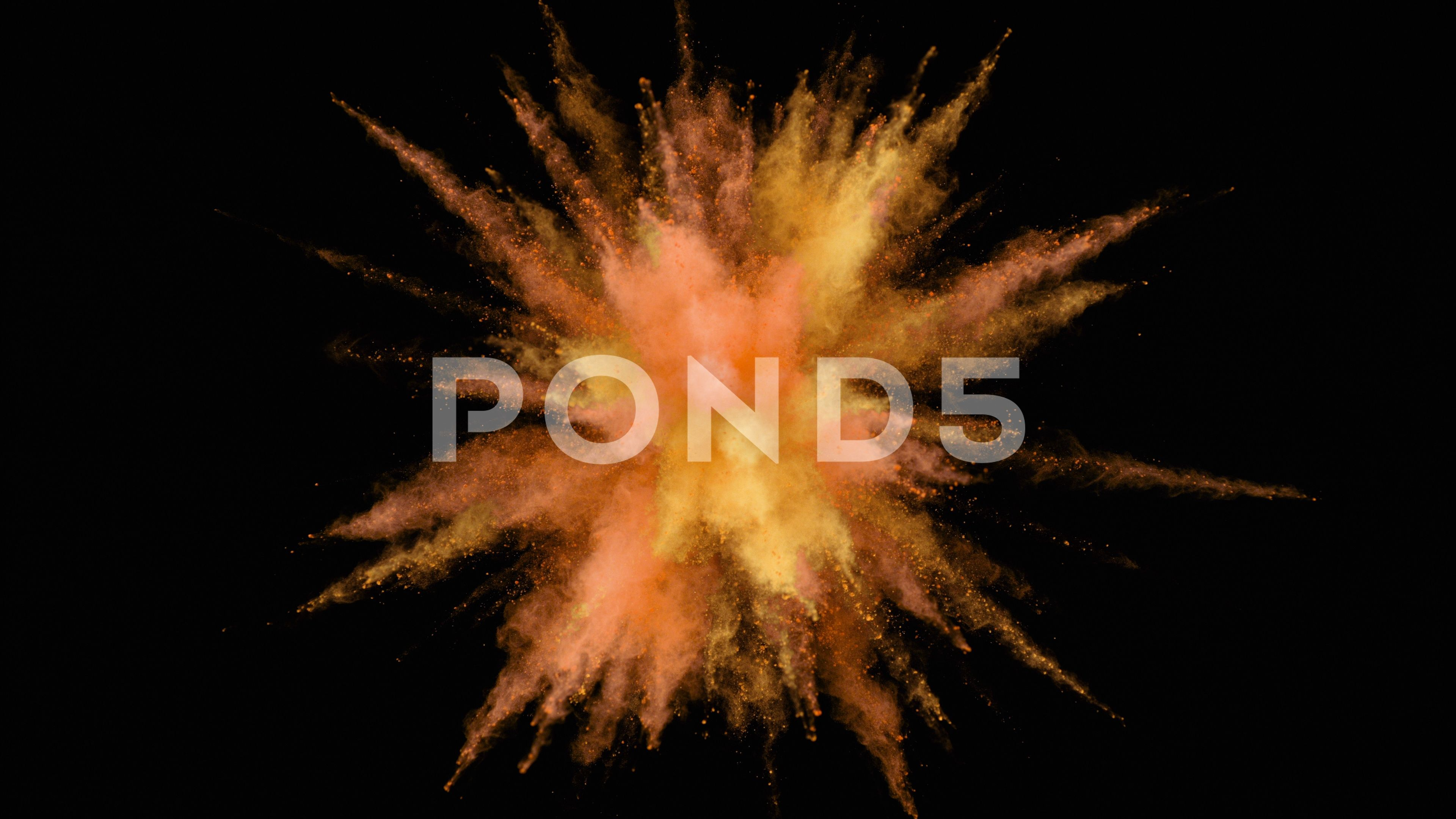 Colorful powderparticles fly after being exploded slow