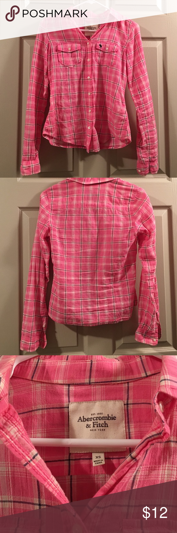 Abercrombie & Fitch pink long sleeved western top Previously loved Abercrombie & Fitch pink western top. Has two front pockets and sleeves with buttons allowing them to be rolled up. In very good condition/not missing any buttons Abercrombie & Fitch Tops Button Down Shirts