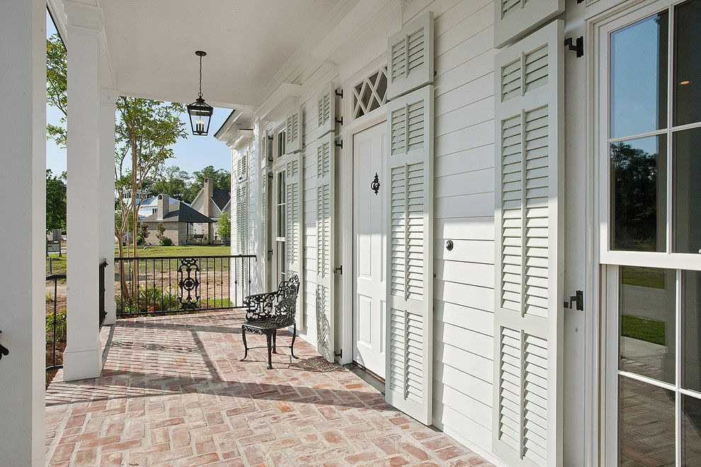 Benjamin Moore Sea Salt For A Traditional Porch With Shutters And New Orleans Charm Private Courtyard By Highland Homes Inc