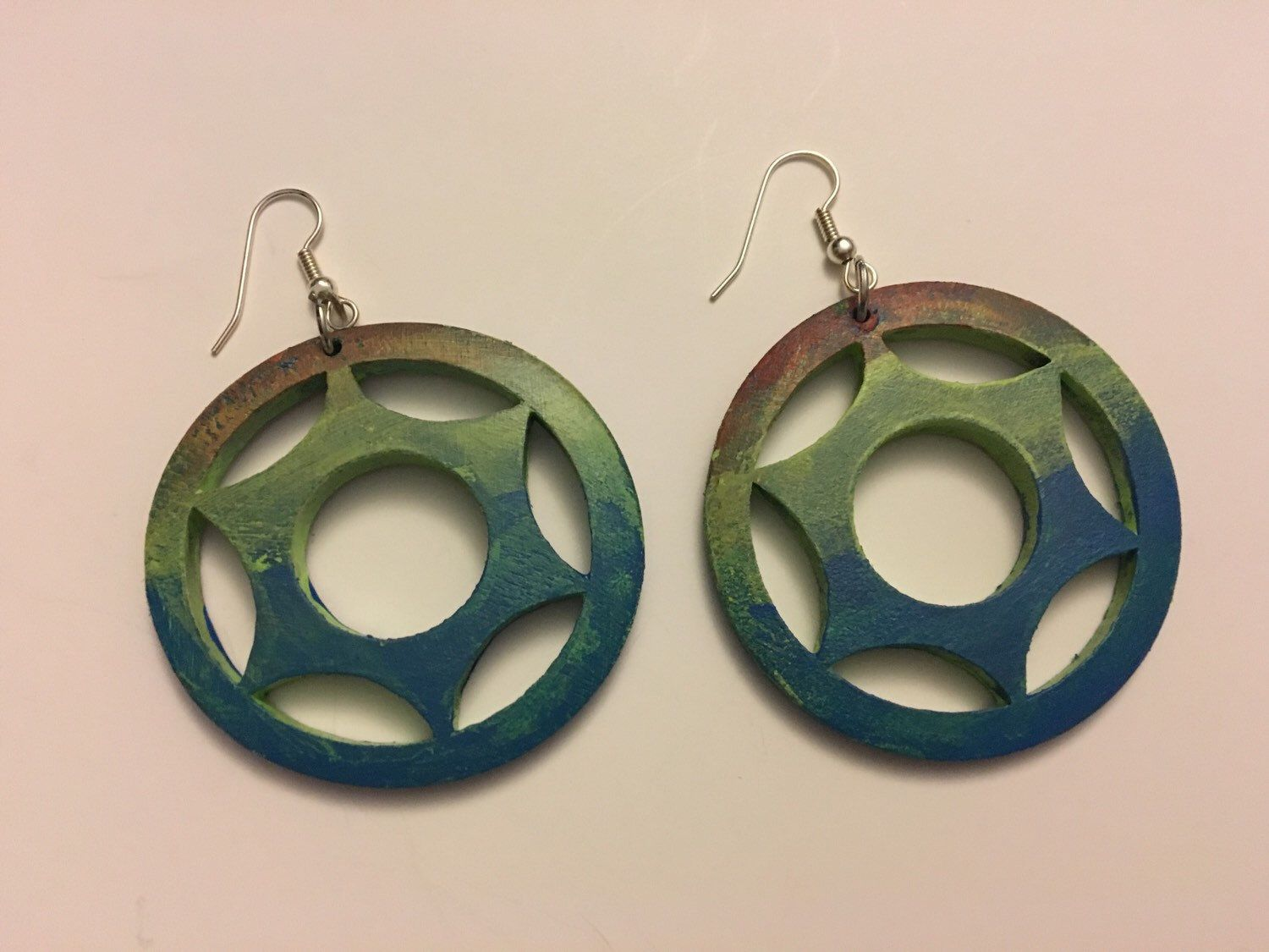 A personal favorite from my Etsy shop https://www.etsy.com/listing/264845927/hand-painted-wooden-filigree-earrings