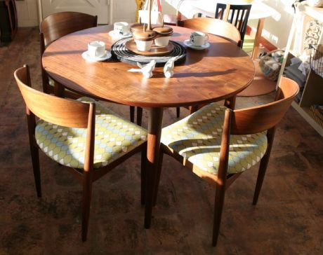 Mid Century Modern Table And Chairs That Have Been Refinished In A Spectacular Fabric