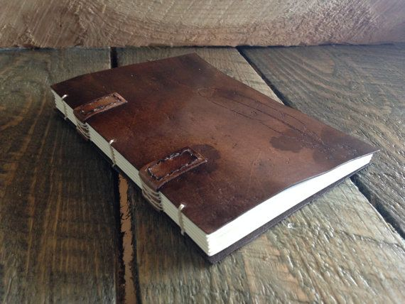 Handbound, handstitched leather book. 192 pages (front and back), cream colored acid free paper. Created on a mountain top in Wyoming.
