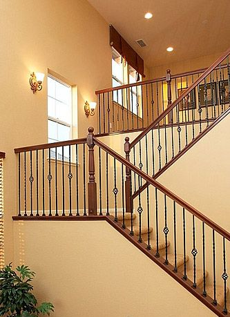 Staircase With Half Landing And Wrought Iron Spindles In