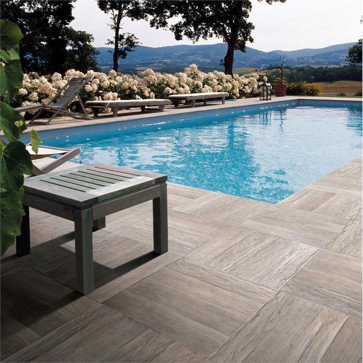 You can use wood look porcelain tile to create a unique for Swimming pool ceramic tile