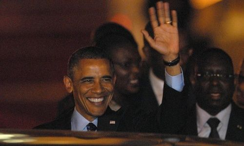 President Barack Obama waves to onlookers as he arrives in Dakar, Senegal on the first stop of a week-long three nation visit of Africa. Photograph: Aliou Mbaye/EPA