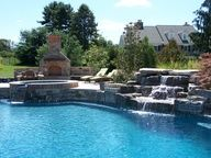 Custom Pool with water features and fireplace for cool summer nights - Home and Garden Design Ideas