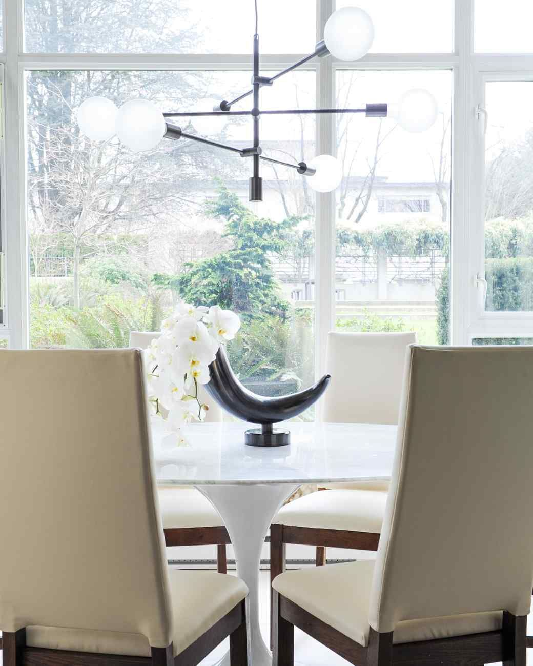 Learn how to decorate like an interior designer hanging chandelier dress up your tabletop dining room decorating ideas martha stewart living a statement vase arubaitofo Gallery