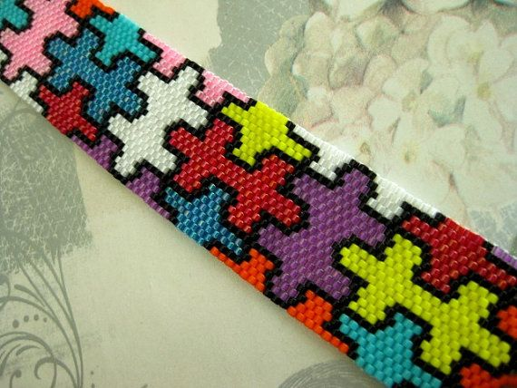 A bracelet pattern made with one drop odd peyote stitch using 11/0 Miyuki delica beads in 9 colors.  Length: 6.92in (17.6cm) Width: 1.11in (2.8cm)