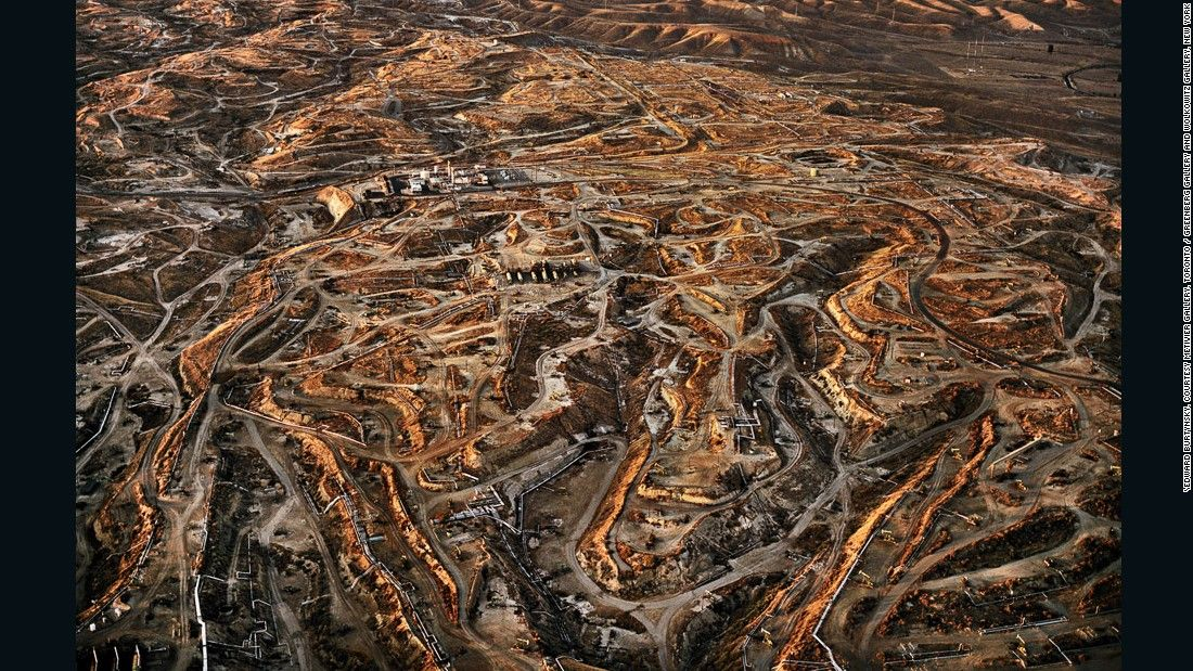 Burtynsky's Oil series challenges our awareness of energy consumption.