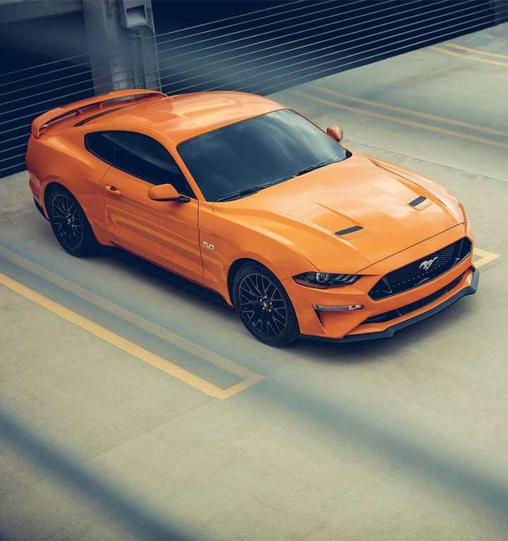 2018 Mustang Gt In Orange Fury Tri Coat Parked In A Parking Lot Ford Mustang Mustang Ford Mustang Car
