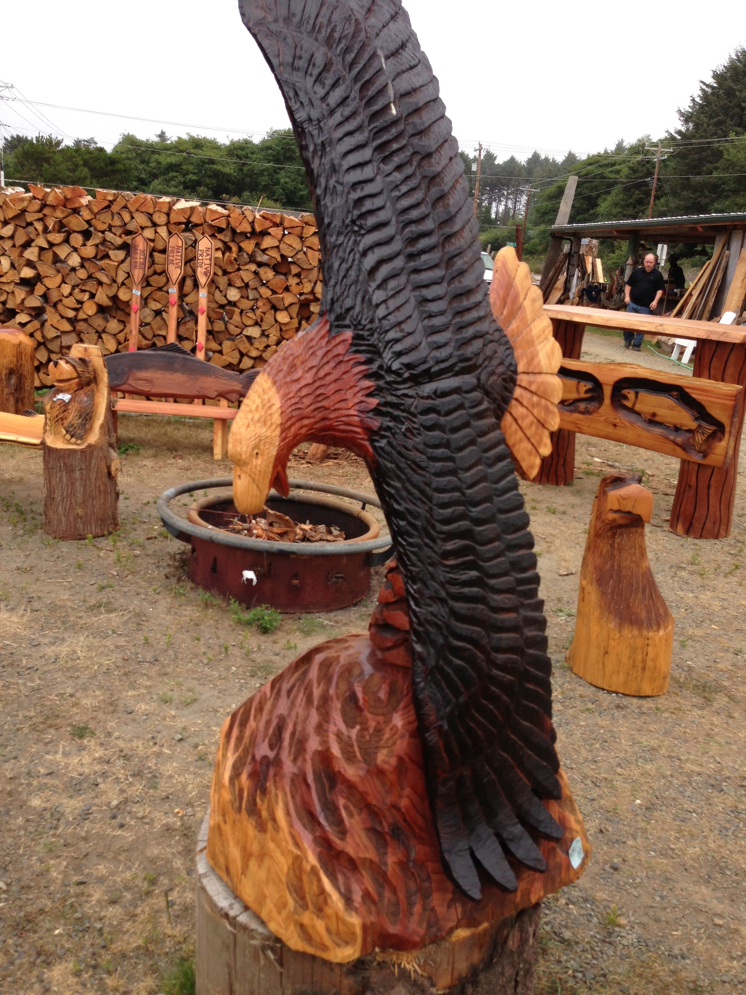 The bend in road chainsaw art and firewood stand