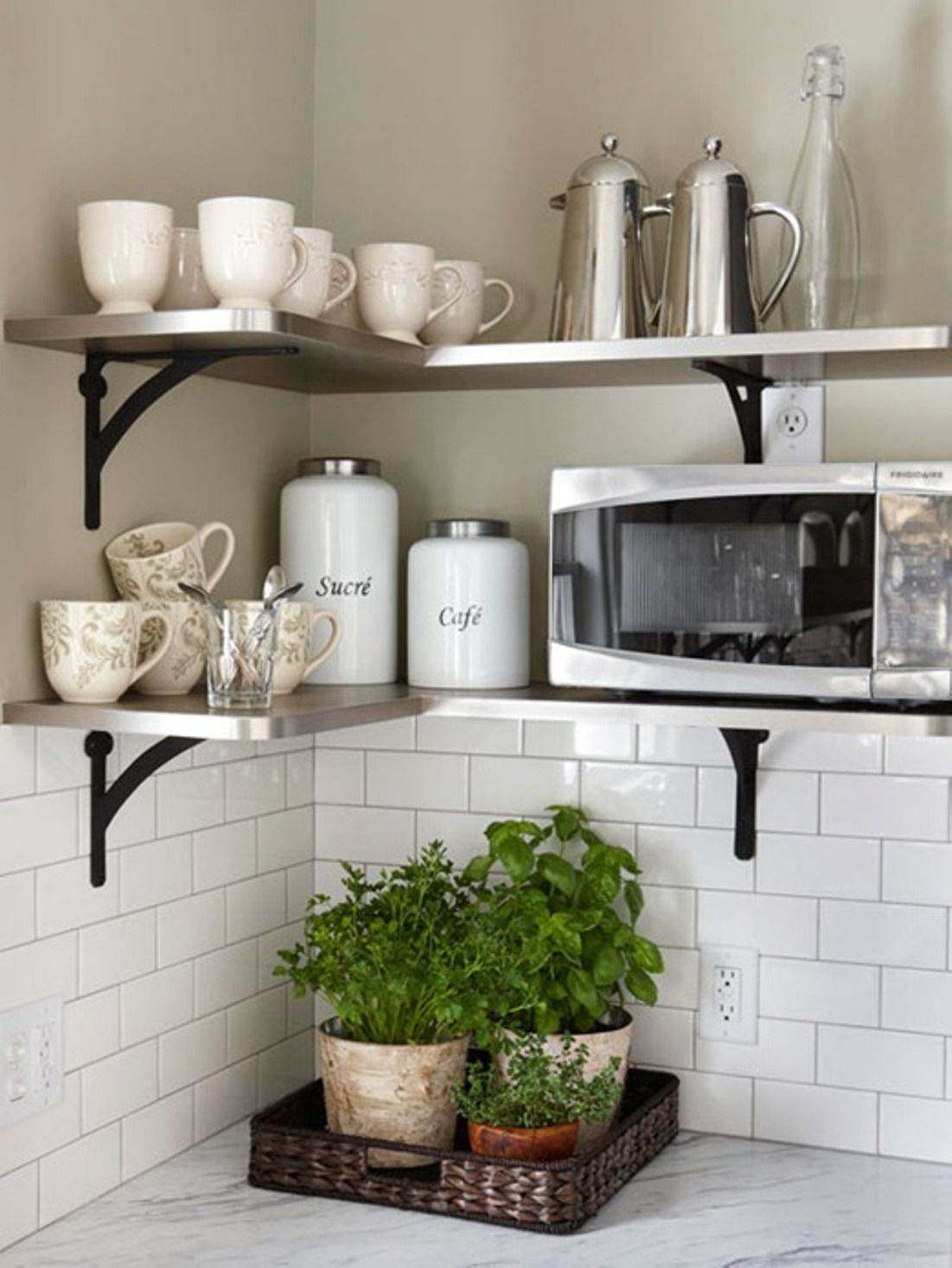 Exceptional Open Kitchen Shelving Tips And Inspiration: Contemporary Stainless Shelves  With Black Iron Brackets, White Subway Tile Backsplash. Plants In Basket  Tray