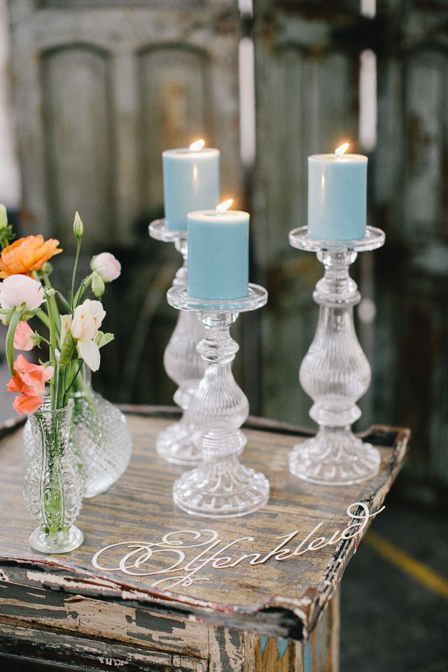 Guest book table- different height candle holders blue candles / Carmen & Ingo Photography