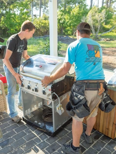 Create an outdoor kitchen by nestling a gas grill into a custom-built, granite-topped island.