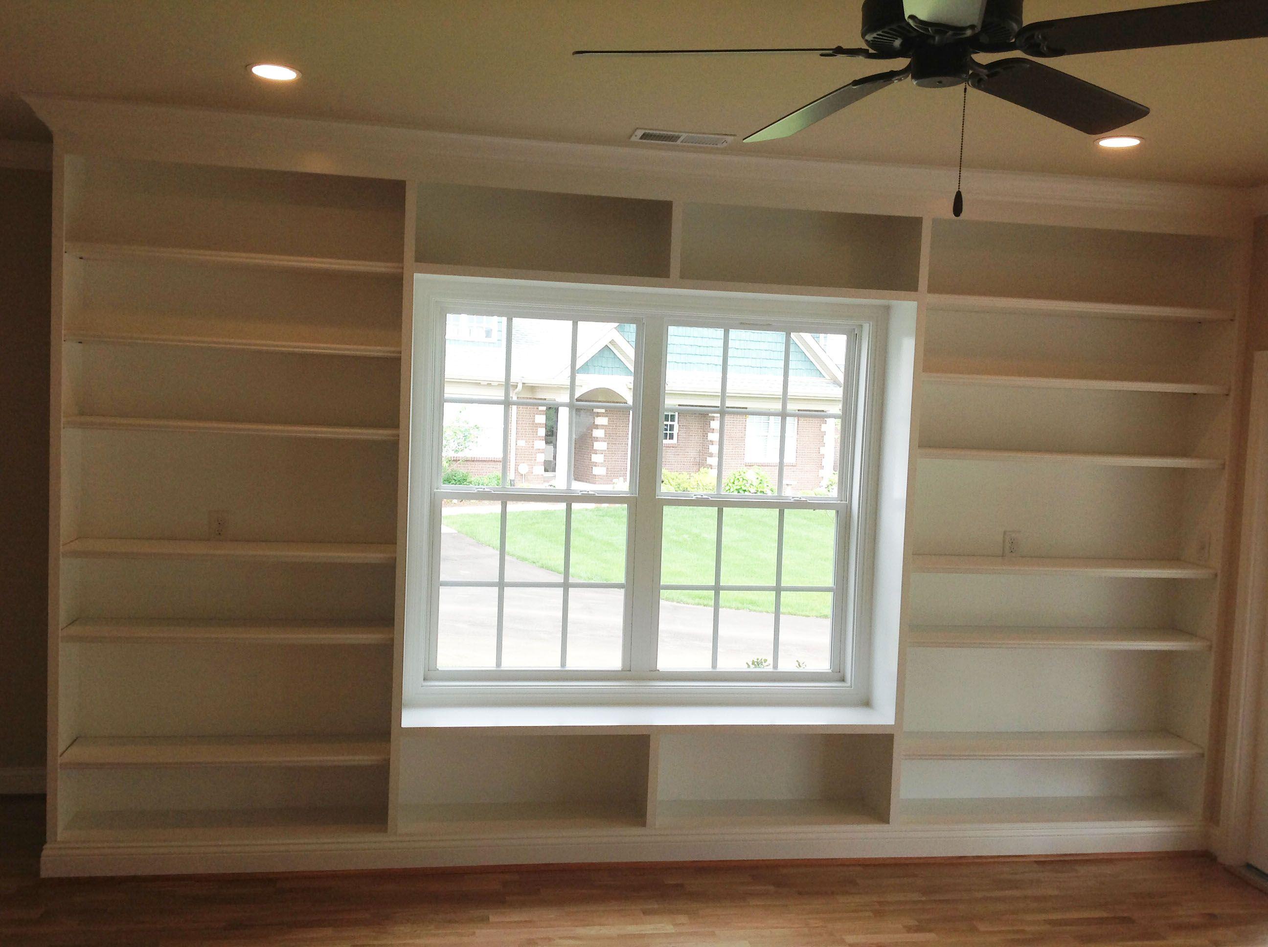 Built in shelves around a window bookshelves built in