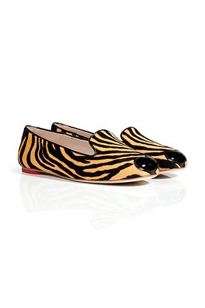Part of a capsule collection with stylist and editor of LOVE magazine Katie Grand, these haircalf slippers from Hogan lend a wild twist to your ensemble