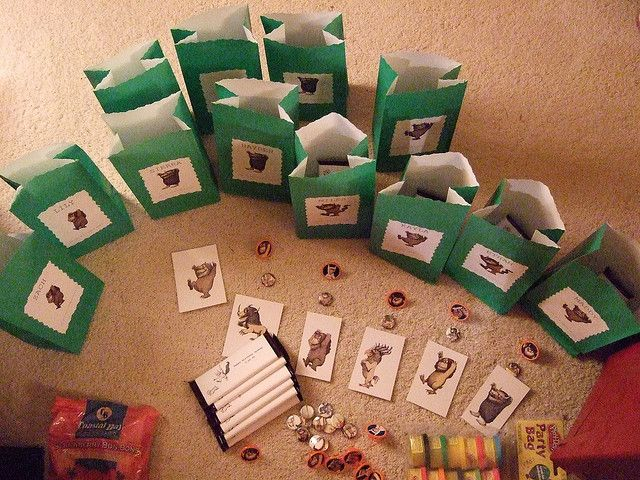 goody bags.... green inexpensive bags w/pics of book characters pasted to front.  Contents: pins, plastic rings, play doh, stickers, candy, plush dolls, paper toys.