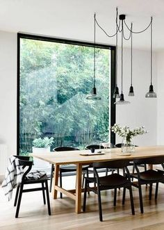 A pared down color scheme fits right in with the minimalist design scheme of this dining room.