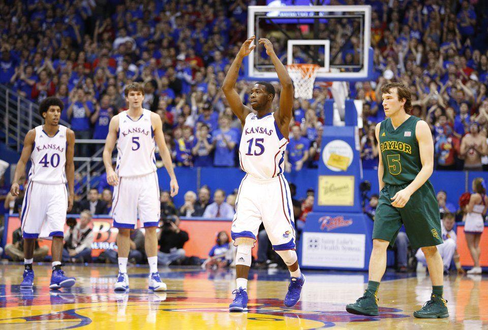 Kansas guard Elijah Johnson raises up the crowd after a