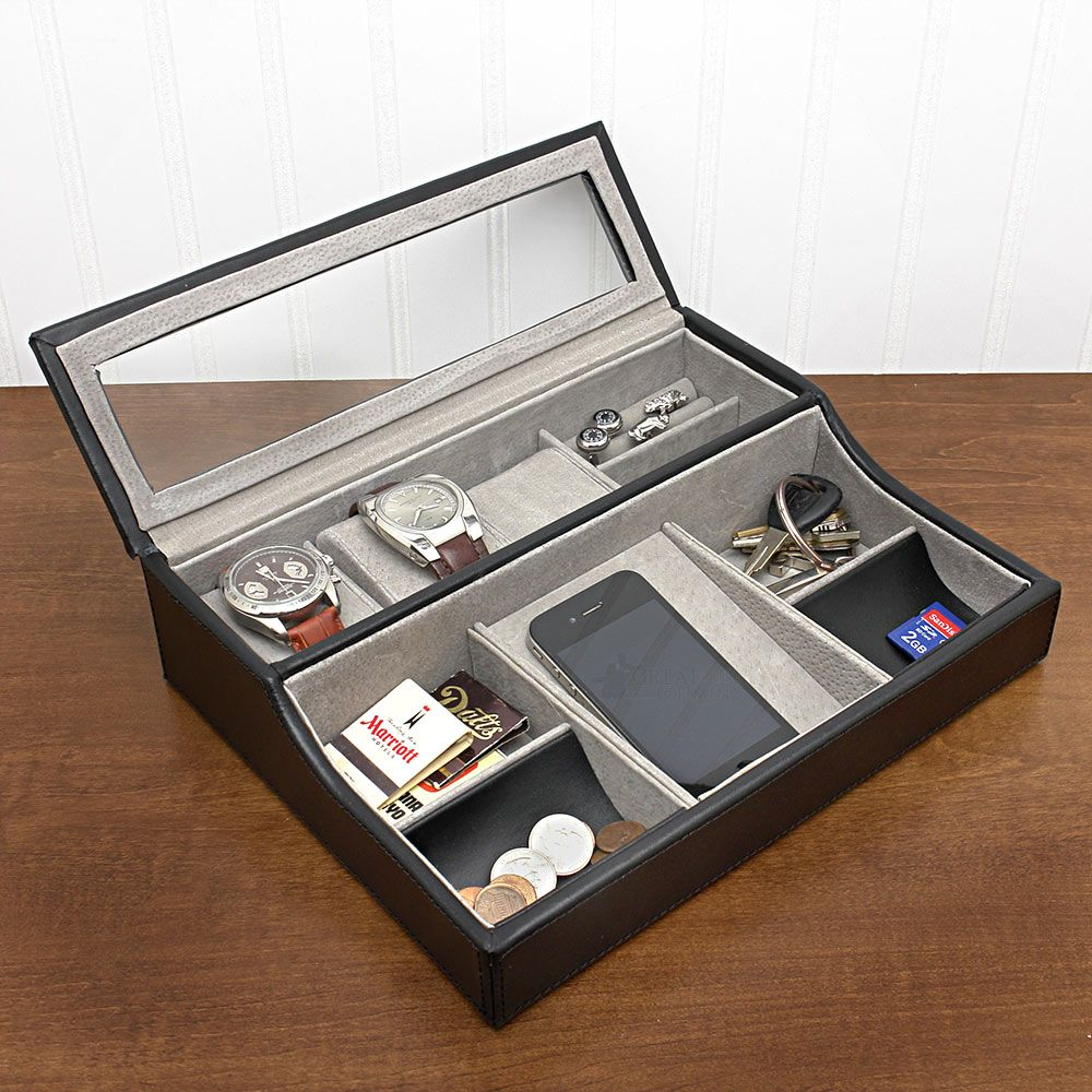 Valet with watch holders and glass cover over the watches ...