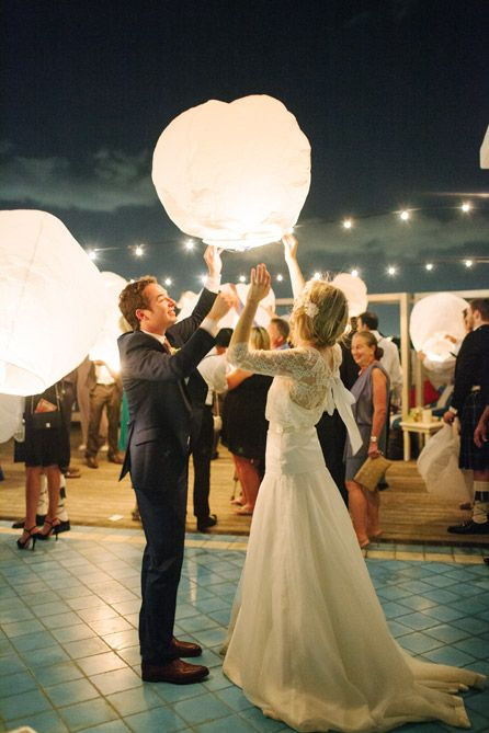 Bride and groom releasing wish lanterns into the sky