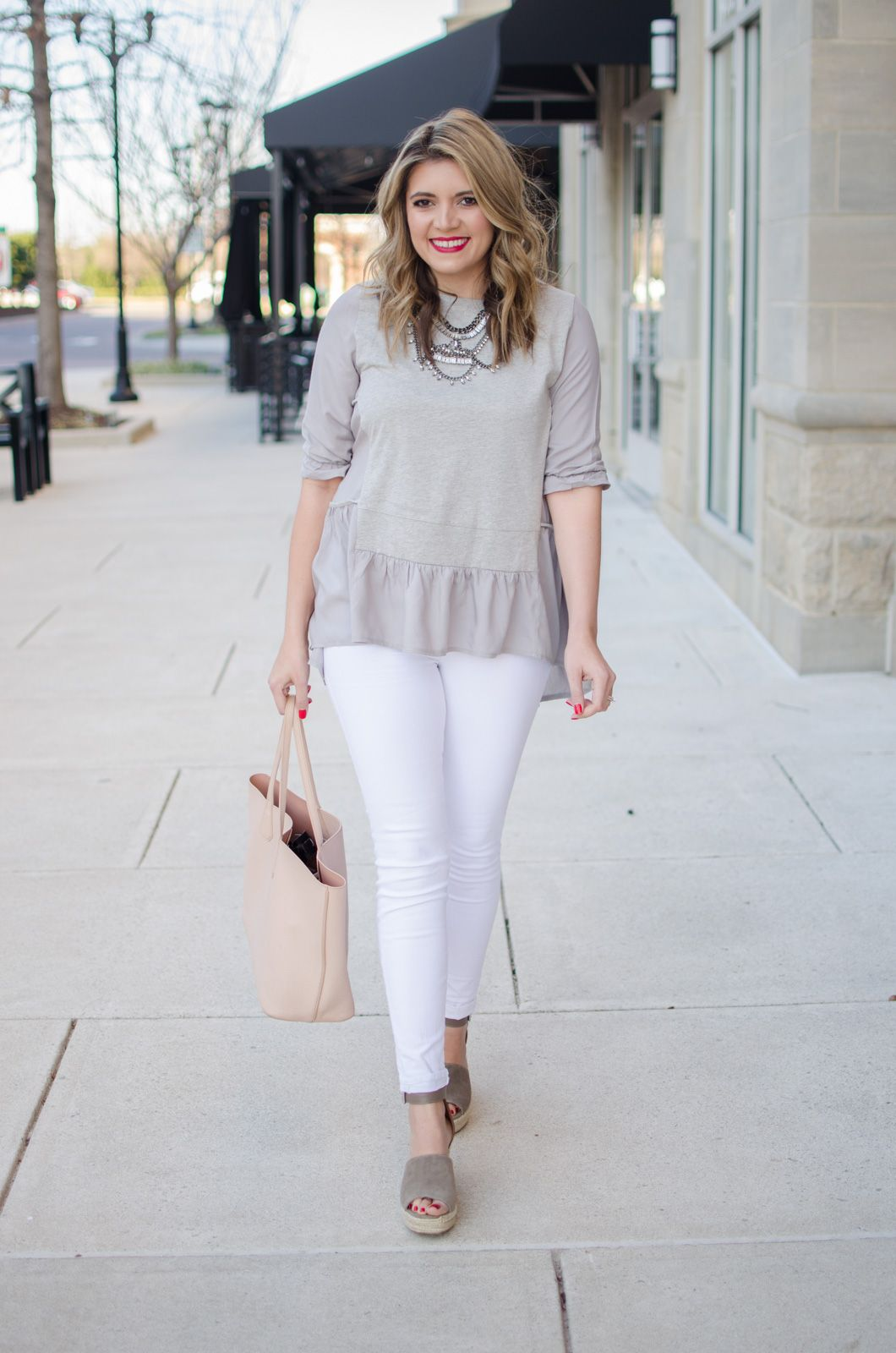 fc285a40cdd early spring outfit idea - gray ruffle tee with white jeans outfit. Click  through for more cute Spring outfits or to shop this look! bylaurenm.com